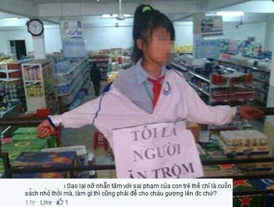 """Facebook """"dậy sóng"""" hình ảnh bé gái đeo biển Tôi Là Người Ăn Trộm -1"""